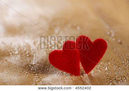 poster of Two Fluffy Hearts On Cracked Painted Desert