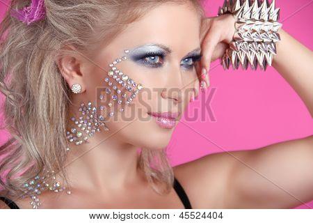 Beautiful Woman With Hair Styling And Evening Make-up. Jewelry And Beauty. Fashion Art Photo. Punk G