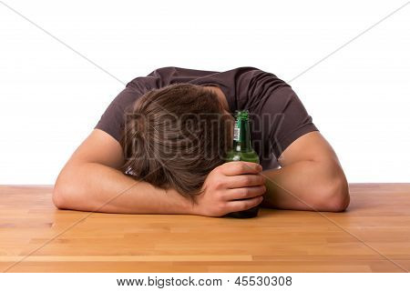 Man Sleeping On A Table With Beer