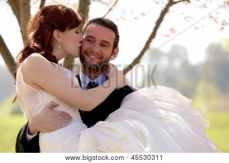 Young Bride Kisses Her Groom