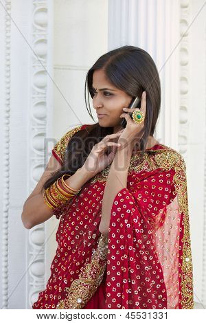 Indian Woman in Sari Talk on Cell Phone