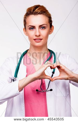 Doctor Showing Heart Sign