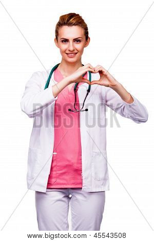 Beautiful Young Doctor Showing Heart Sign