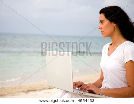 Beach Woman On A Laptop