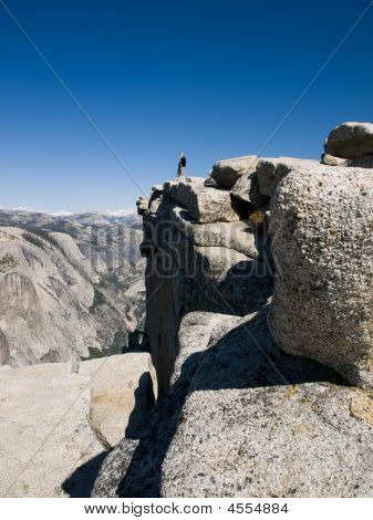 Man And Squirrel Over Look Yosemite Valley