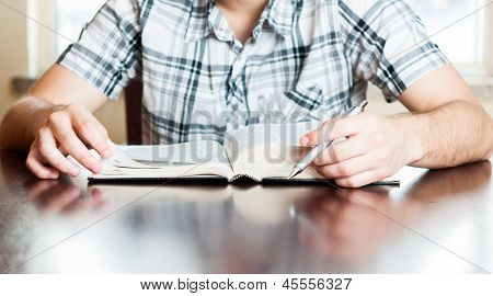 Hispanic Teenager Reading The Bible