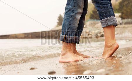 Closeup Image Couple Legs At The Beach