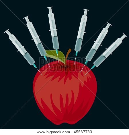 Red apple and syringes on a black background