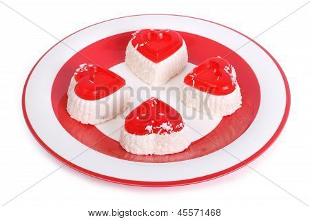 cheese cakes isolated on a white on a red plate