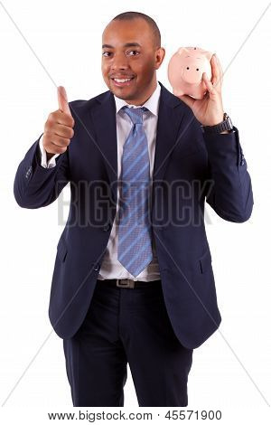 African American Business Man Holding A Piggy Bank Making Thumbs Up - African People