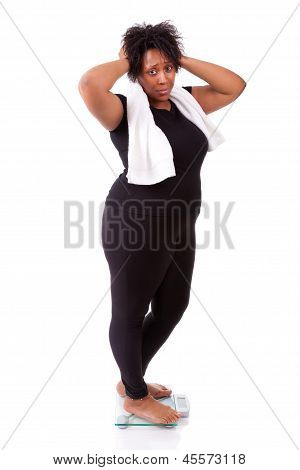 Disappointed African American Woman Using A Scale  - African People