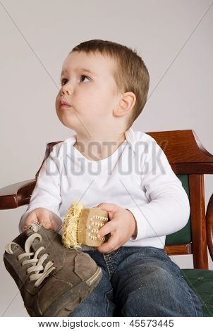 Boy with shoe