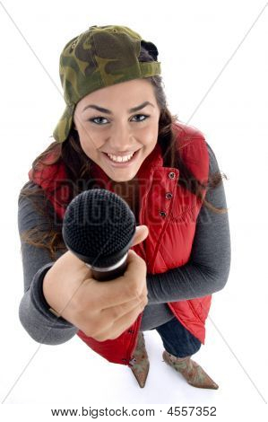 Young Caucasian Offering Her Microphone