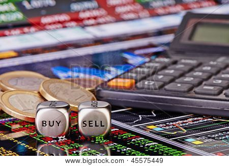 Dices Cubes With Words Sell Buy For Trader, Euro Coins And Calculator. Financial Chart As Background