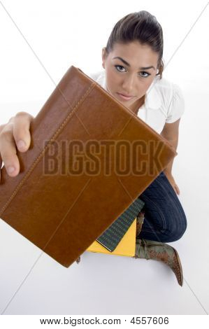 Close Up View Of Teenager Student Showing Book