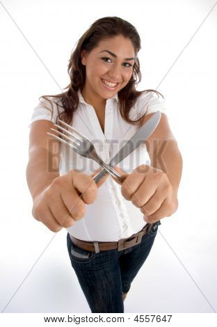 Cute Teenager Showing Cutlery