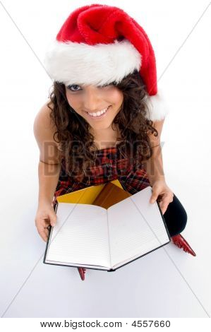 Smiling Student With Christmas Hat And Books