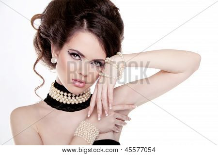 Jewelry And Hairstyle. Fashion Portrait Of Beautiful Woman With Pearls Isolated On White Background.