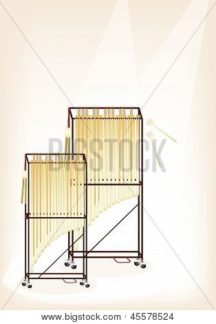 A Musical Tubular Bells On Brown Stage Background