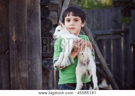 boy with little goat