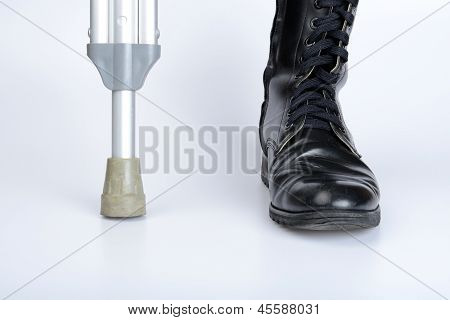 Combat Boot And Crutch For War Concept