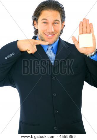 Isolated Young Businessman Pointing At Empty