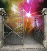 stock photo of iron star  - entrance of a graveyard with a open wrought - JPG