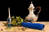 foto of eucalyptus leaves  - Aromatic eucalyptus seeds and leaves in a still life - JPG
