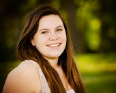 pic of adolescent  - Portrait of happy teenage or adolescent girl outdoors - JPG
