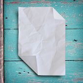 Wrinkled Paper With Grunge Wood Background On Green Color.