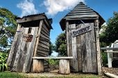 stock photo of outhouse  - Classic country outhouse toilets with waiting area provided - JPG