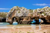 picture of cave woman  - Beach of Cuevas del Mar Nueva de Llanes  - JPG