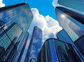 stock photo of clouds  - Downtown corporate business district architecture concept - JPG