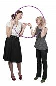 picture of hulahoop  - Couple of beautiful young women who are the best of friends with a hula hoop - JPG