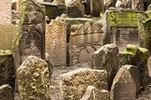 stock photo of headstones  - Old gravestones in the historic Jewish Cemetery in the Josefov section of Prague - JPG