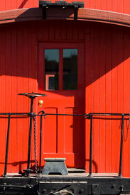 pic of caboose  - Red caboose rear door on sunny day - JPG