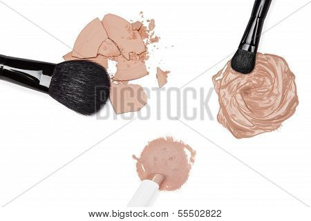 Foundation, Concealer And Powder With Makeup Brushes