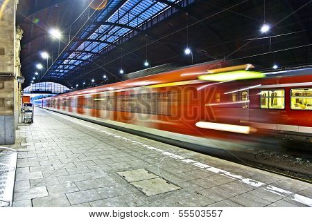 WIESBADEN, GERMANY - MAR 30, 2012: train in motion enters the statin in late afternoon