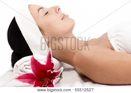Young woman relaxing eyes closed in beauty parlour.