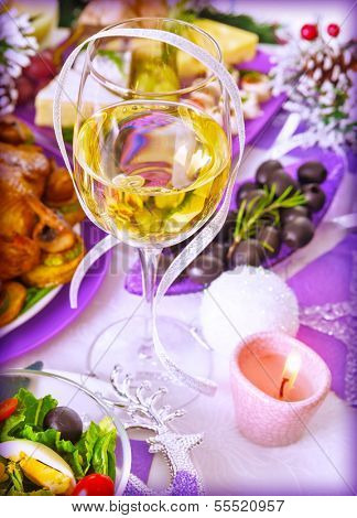 Traditional New Year beverage, champagne, glass with white wine, tasty festive food, romantic dinner, holiday celebration concept