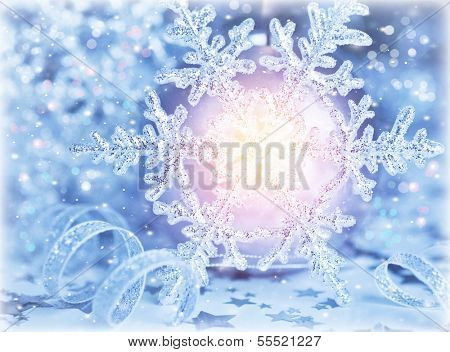 Beautiful shiny snowflake with bright light in centerpiece, festive Christmastime background, holiday greeting card, wintertime ornament