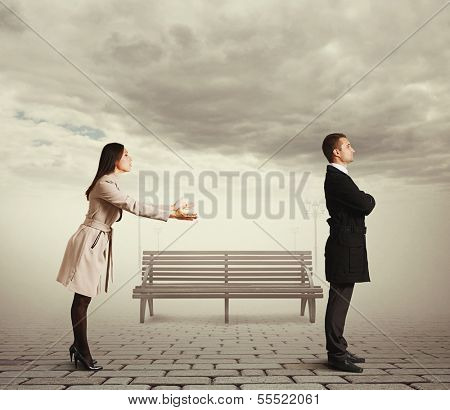young woman apologizing to man at outdoor