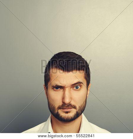 pensive man looking at camera