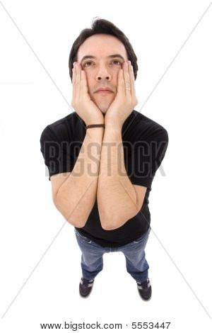 Young Depressed Man With The Hands At Face On White