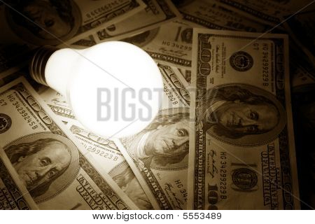 Bright Light Bulb And Dollar