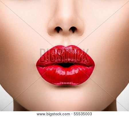 Sexy Lips. Beauty Red Lip Makeup Detail. Beautiful Make-up Closeup. Sensual Open Mouth. lipstick or Lipgloss. Kiss. Beauty Model Woman's Face close-up. Valentine Kiss