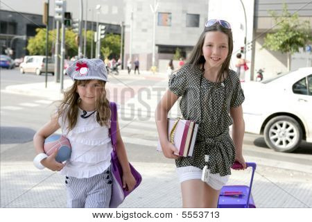 Little Student Girls Going To School In City