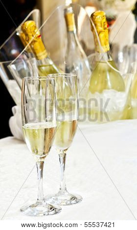 Couple of glasses Of champagne on a table