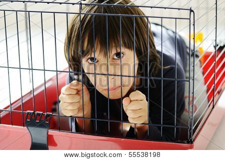 Kid in cage prisoned