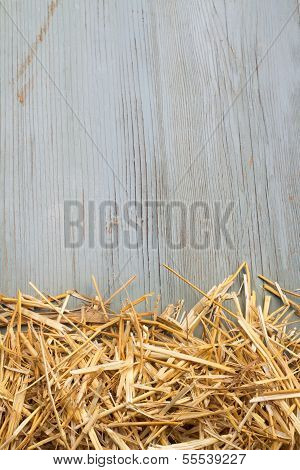 hay against an old wooden wall